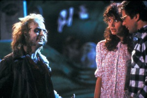 Geena Davis , Alec Baldwin , Michael Keaton Directed by Tim Burton